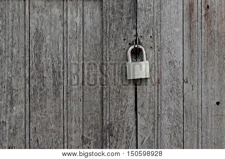 Old Padlocked On Wooden Door