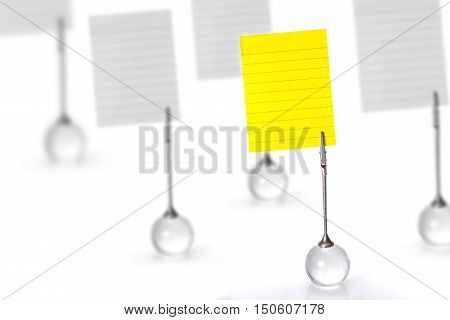 Silver Business Card Holder with yellow paper note on white background