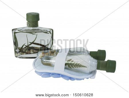 Cone Shaped bottles that contain bath salts with bath scrub for a relaxing bath