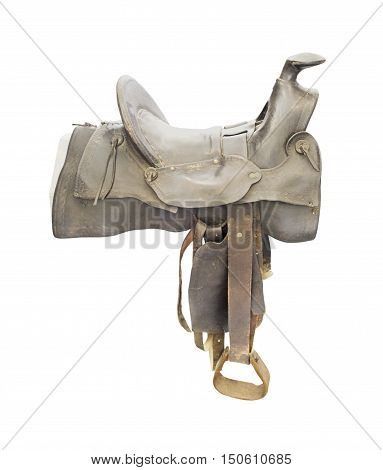 Old Saddle made of heavy brown leather for riding domestic horses
