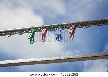 Plastic Clothespin On A Clothesline.