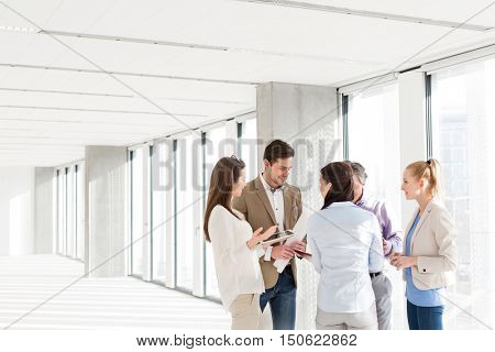 Business people having discussion in new office