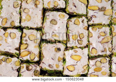 Close-up of Turkish pistachio locum. Confectionery background.
