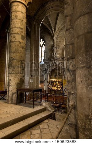 Poitiers France - September 12 2016: Very old church Notre Dame la Grande in Poitiers France in the interior of one of the side altars with a statue of the Virgin Mary with Jesus