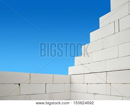 Building a white brick wall. Bricklaying work.
