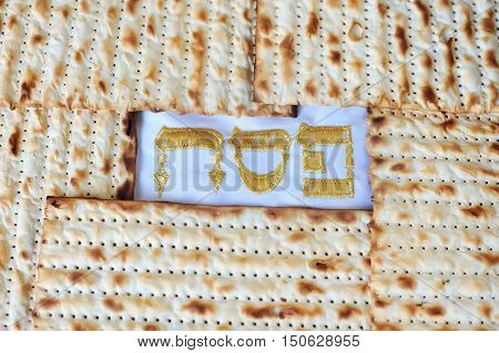 Traditional Jewish Matzo sheet on a Passover Seder table. Passover is a predominantly Jewish holy day and festival. It commemorates the story of the Exodus in which the ancient Israelites were freed from slavery in Egypt.
