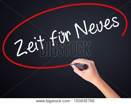 Woman Hand Writing Zeit F�¼r Neues (time For Something New In German) With A Marker Over Transp