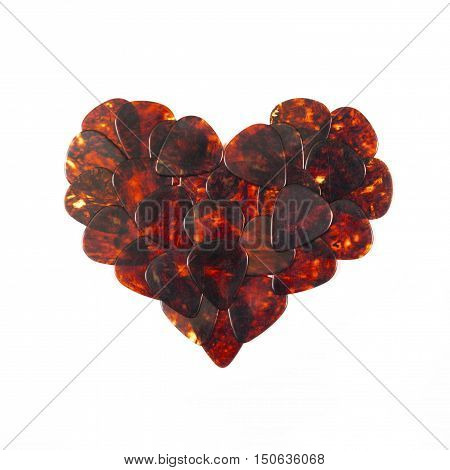 Guitar plectrums isolated on a white background.Music and Valentine's Day concept