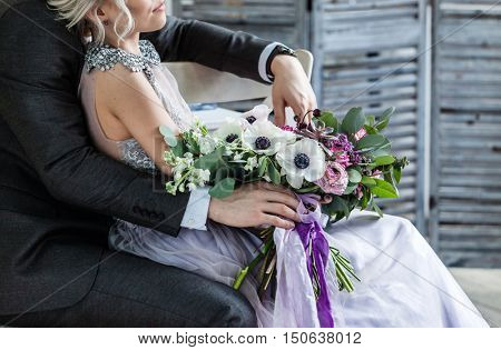 groom and bride with flowers