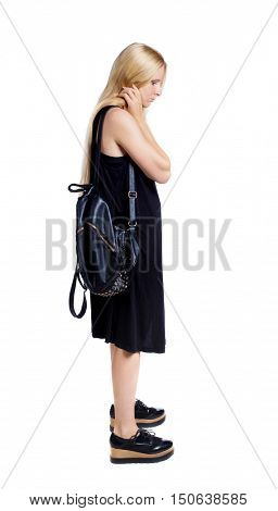 Side view of the distressed girl with a backpack.  girl  watching. Rear view people collection.  backside view of person.  Isolated over white background. The girl with a leather backpack looks down