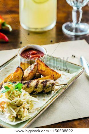 kebab with potatoes and salad