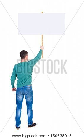 Back view man showing sign board. man holds information plate. Rear view people collection. backside view of person. Isolated over white background. The man in the green jacket holding a big poster in