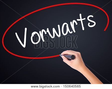 Woman Hand Writing Vorwärts  (forward In German)  With A Marker Over Transparent Board