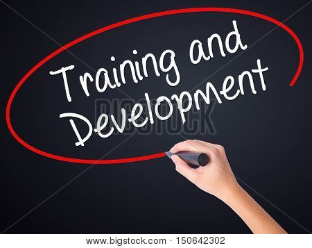 Woman Hand Writing Training And Development With A Marker Over Transparent Board