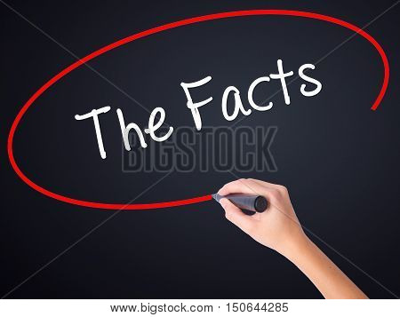 Woman Hand Writing The Facts  With A Marker Over Transparent Board