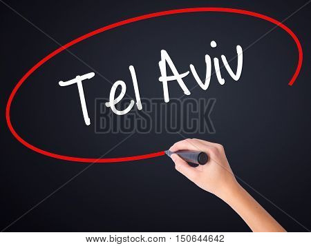 Woman Hand Writing Tel Aviv  With A Marker Over Transparent Board