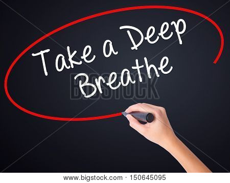 Woman Hand Writing Take A Deep Breathe With A Marker Over Transparent Board