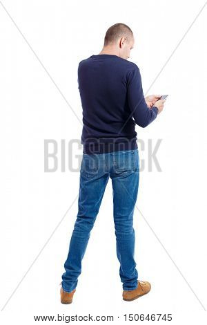 back view of man in suit  talking on mobile phone.    rear view people collection. Isolated over white background. backside view of person. A guy in a black sweater finger looking at smart phone.