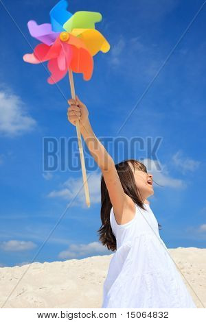 Girl playing on beach