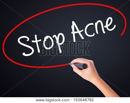 Woman Hand Writing Stop Acne  With A Marker Over Transparent Board .