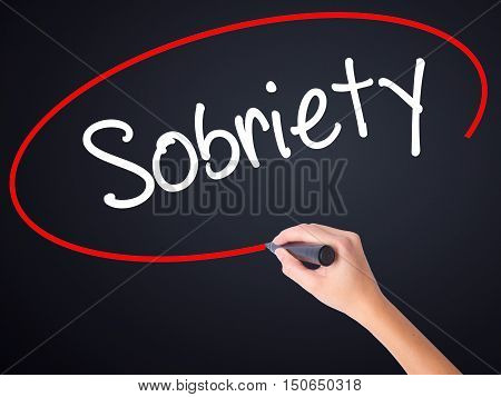 Woman Hand Writing Sobriety With A Marker Over Transparent Board