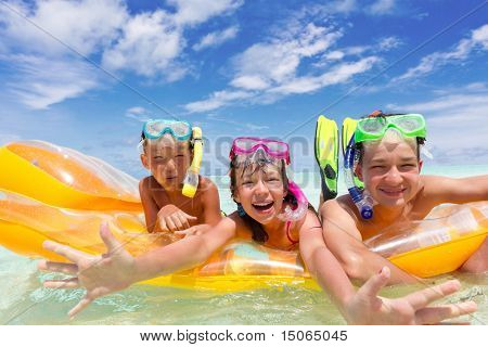 Three kids on a raft.