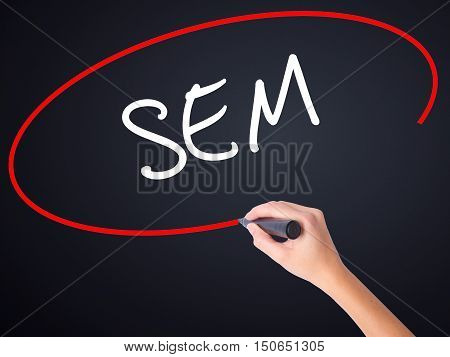 Woman Hand Writing  Sem (search Engine Marketing) With A Marker Over Transparent Board