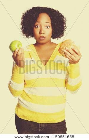 Apple or hamburger food choice woman