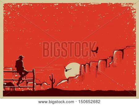American cowboy sitting on fence .American ranch background for text or design