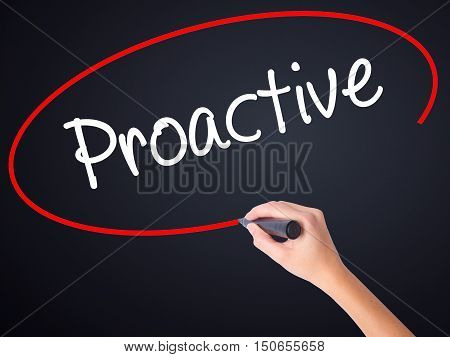 Woman Hand Writing Proactive With A Marker Over Transparent Board .