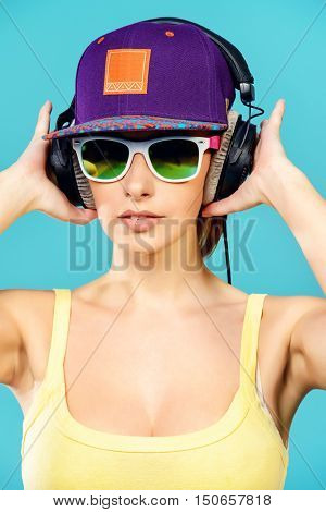 Modern young woman enjoys listening to music in headphones. Positive emotions, leisure.