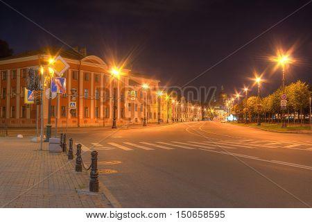 Night view of illuminated Lieutenant Schmidt Embankment in Saint Petersburg Russia