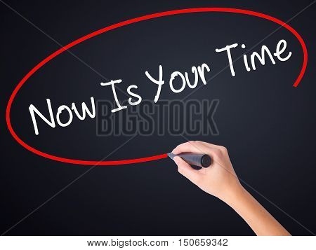 Woman Hand Writing Now Is Your Time  With A Marker Over Transparent Board