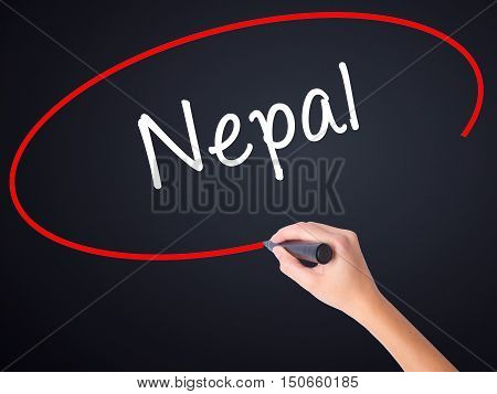 Woman Hand Writing Nepal  With A Marker Over Transparent Board