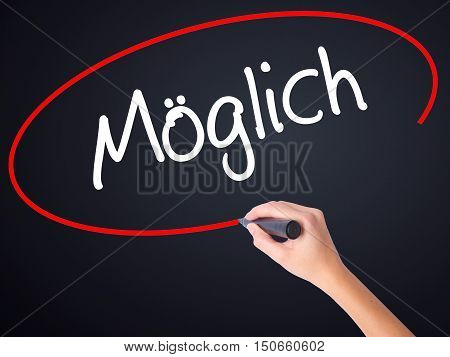 Woman Hand Writing Moglich (possible In German) With A Marker Over Transparent Board .