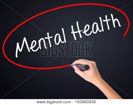 Woman Hand Writing Mental Health With A Marker Over Transparent Board