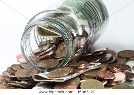 Collection Of Coins In A Jar