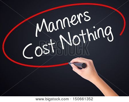 Woman Hand Writing Manners Cost Nothing With A Marker Over Transparent Board