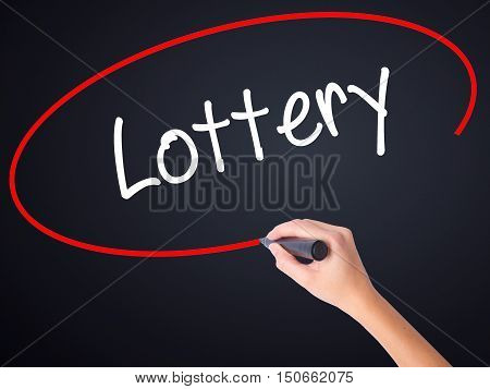 Woman Hand Writing Lottery  With A Marker Over Transparent Board