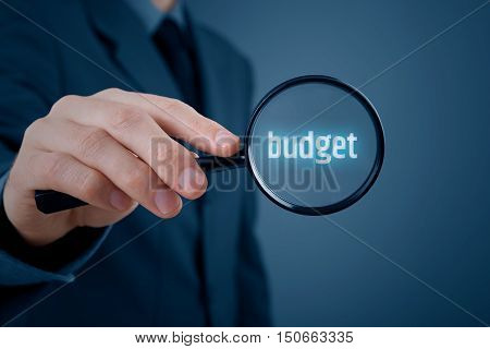 Businessman (accountant, financial manager) is focused on budget.