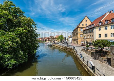 Bamberg Germany - May 22 2016: Scenic spring view with flowering chestnut tree of the Old Town pier architecture in Bamberg Bavaria Germany.