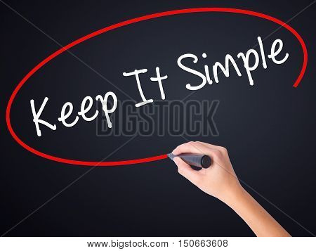 Woman Hand Writing Keep It Simple With A Marker Over Transparent Board