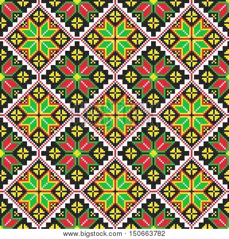 Embroidered old handmade cross-stitch ethnic Ukrainian pattern. Seamless floral ornament