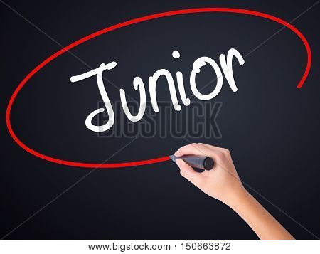 Woman Hand Writing Junior With A Marker Over Transparent Board