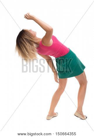 Balancing young woman.  or dodge falling woman. Rear view people collection.  backside view of person.  Isolated over white background. Girl in a green skirt falls on his back.