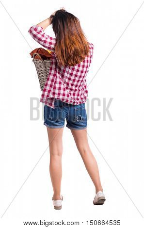 Back view of woman with  basket of dirty laundry. girl is engaged in washing. Rear view people collection.  backside view of person.  Isolated over white background. Girl in shorts holding a laundry
