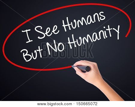Woman Hand Writing I See Humans But No Humanity With A Marker Over Transparent Board .