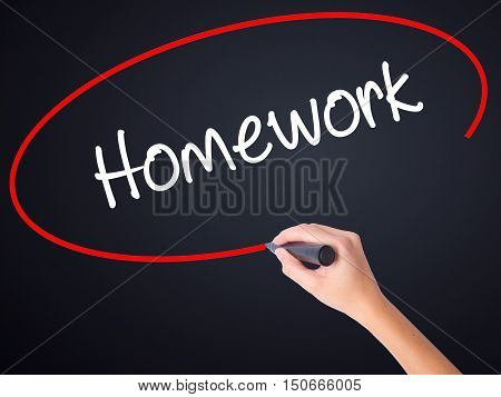 Woman Hand Writing Homework With A Marker Over Transparent Board