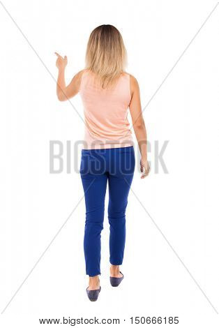 back view of pointing walking  woman. going girl pointing.  backside view of person.  Rear view people collection. Isolated over white background. The blonde in a pink t-shirt goes the distance