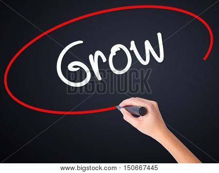 Woman Hand Writing  Grow With A Marker Over Transparent Board